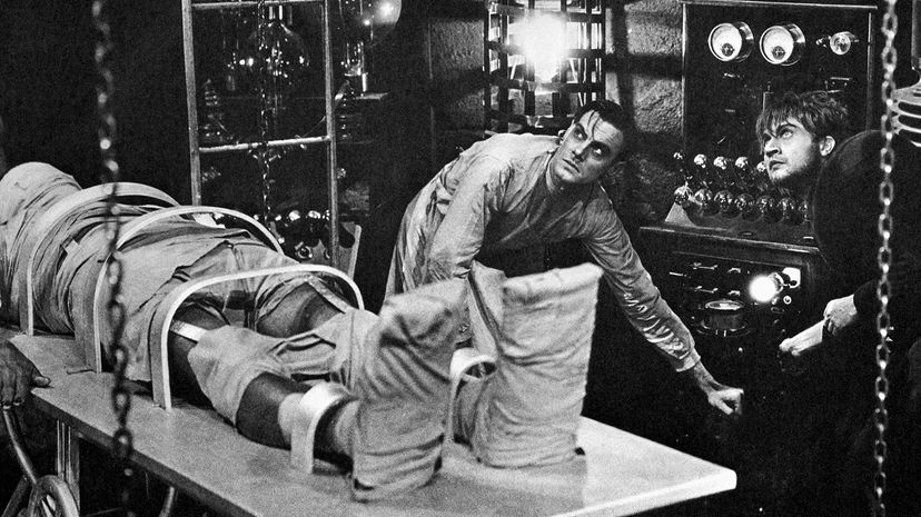 Colin Clive, as Dr. Frankenstein, and Dwight Frye, as his assistant Fritz, prepare to bring their monster to life in a scene from the 1931 movie