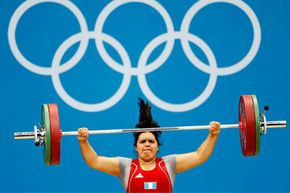 Guatemalan Olympian Astrid Roxana Camposeco Hernandez hoists 165 pounds (75 kilograms) over her head. See more Olympics pictures.