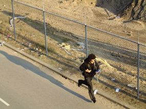 """An urban gamer running while playing """"Can You See Me Now?"""""""