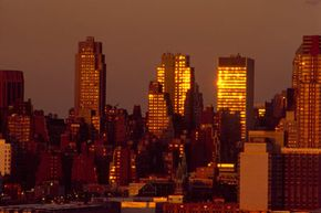 New York's buildings and asphalt help capture the sun's light and results in warmer temperatures.