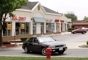 In suburbia, you can expect to see many strip malls like this one in Palatine, Ill. The closer businesses are to cities, the more rural space can be preserved.