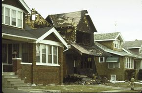 One reason for urban sprawl? People moving away from inner cities, where more crime usually takes place. This Detroit crack house was burned down by neighbors in an act of vigilante justice.