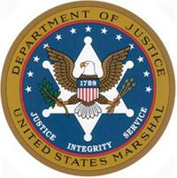 Courtesy of the U.S. Federal Government The seal of the U.S. Marshals Service