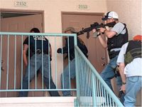 U.S. Marshal multi-agency team knock and announce during an operation.