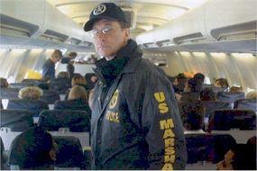 U.S. Marshal transporting prisoners via the Justice Prisoner and Alien Transportation System.