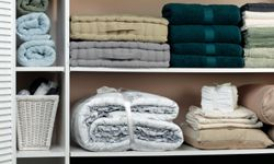 An underused closet is perfect for some freestanding shelves.