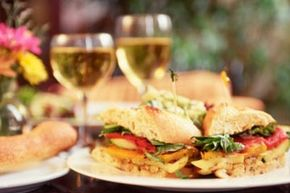 This roasted vegetable sandwich is complemented by a vegan white wine.