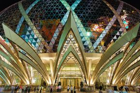Macau's Grand Lisboa Casino glitters like a crown at night.
