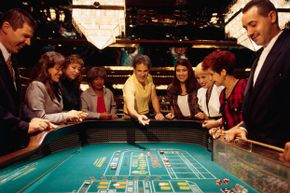 Guests shoot craps at Puerto Rico's Conrad San Juan Condado Plaza.