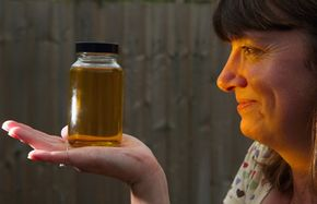 Louise Bailey shows off a sample of homemade biodiesel derived from recycled cooking oil. Is this the future of our commute?
