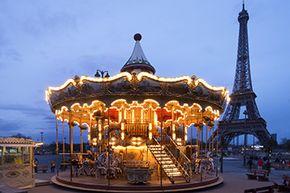 A carousel sits near the Eiffel Tower in Paris.