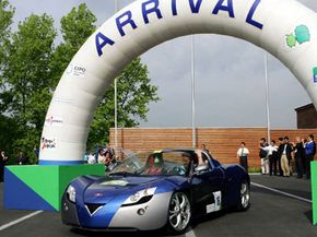 The Venturi Fetish prototype battery electric sports car goes through the arrival gate in front of the Aichi Expo 2005 guesthouse upon its arrival from Kyoto in an eco-car rally in Nagakute, central Japan, on June 9, 2005. See more electric car pictures.