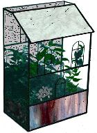 A terrarium provides a humid, moist environment for plant growth.
