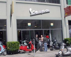 A Vespa store selling many varieties and colors.