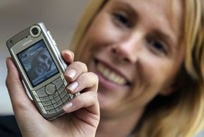 Walk, talk and gawk: This phone model includes a front-facing camera so that users can video chat with each other. See more pictures of cell phones.