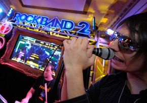 """Video games like """"Rock Band"""" offer realistic graphics. Video-game designers need graphics skills and knowledge of computer programming. See more video game system pictures."""