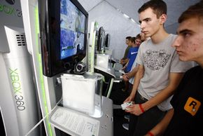 """Video-game testers check out video games before their wide release. Here fairgoers test the new Xbox """"Halo 3."""""""