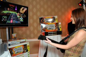 Actress Leighton Meester checks out the new Guitar Hero III after its release.