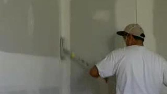 Why do drywall screws pop out?