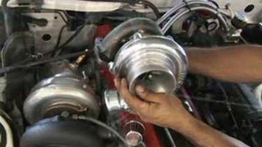 How do you make a wastegate adjustment on a turbocharger?