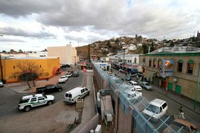Physical fencing is still considered essential in areas like this one, where Nogales, Arizona (left) is separated from Nogales, Mexico.