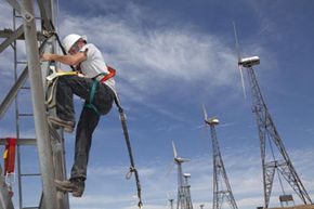 A recently laid-off Ohio plumber, enrolled in the Cerro Coso Community College wind turbine technician class, performs his maiden climb on a wind turbine.
