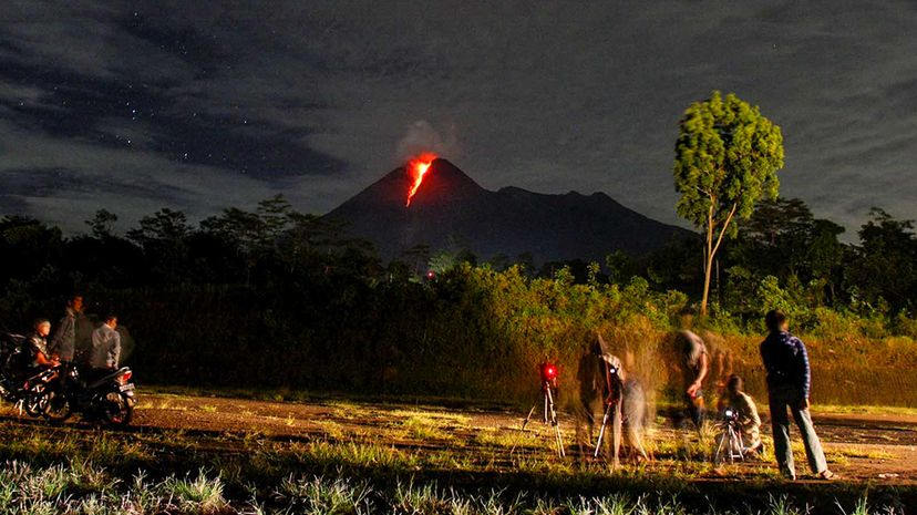 The volcano Mount Merapi, in Central Java, Indonesia erupts on Nov. 2, 2010, while onlookers photograph the event. WF Sihardian/EyeEm/Getty Images