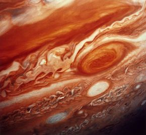 Jupiter's Great Red Spot, which extends from the equator to the southern polar latitudes, as seen by the space probe Voyager 2 in 1979.