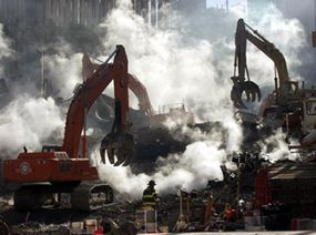 Excavators sort through the rubble at ground zero, a month after the attack.