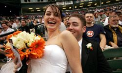 Sports fans could hold their wedding at their favorite ballpark -- or at least stop by afterward, like this couple did at Camden Yards in Baltimore, Md., in 2005.