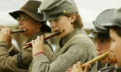 Have a band of period-accurate reenactors -- such as these flute-playing Civil War reenactors at Gettysburg, Penn. -- perform as you walk the aisle or during the reception.
