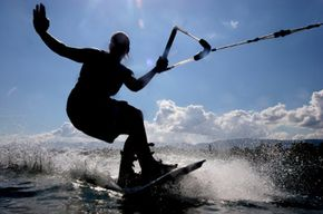Wakeboard enthusiasts like this one in Geneva, Switzerland, enjoy the thrill of the ride.