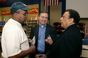 Ambassador Andrew Young with Lawrence Jackson, executive vice president of Wal-Mart's people division, Lee Scott, president and CEO of Wal-Mart Stores, Inc.