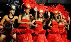 The pre-marathon luau features traditional dancing in Waikiki.