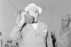 Prime Minister Winston Churchill speaking on a walkie-talkie during a visit to Fort Jackson in June 1942.