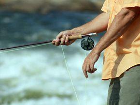 Man holding fishing rod, close-up