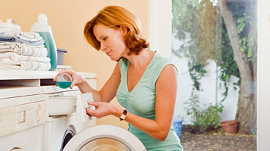 How do washing machines get clothes clean?
