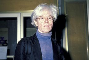 Artist Andy Warhol stands outside New York City's Broadway Theatre in May 1984.