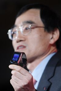 LG CTO Woo Hyun Paik holds up a little gadget that made a big splash at CES 2009: LG's watch phone.