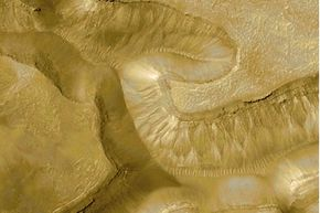 This photo, taken by NASA's Mars Global Surveyor Mars Orbiter Camera in May 2000, shows gullies created by liquid water.