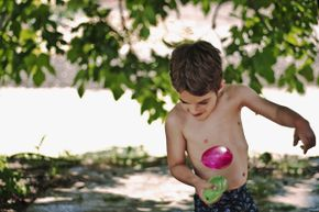 In a water balloon race, you have to get to the other side without breaking your balloon.