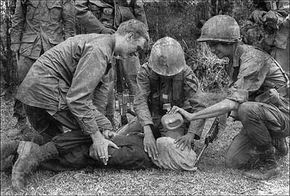 Vietnam, 1968: A U.S. soldier questions an enemy suspect with the help of a water-boarding technique.