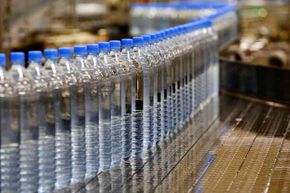 A chemistry professor has devised a system to remove arsenic from drinking water using chopped up beverage bottles like these.