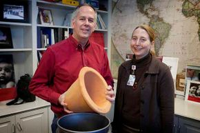 University of Virginia engineer Jim Smith and Dr. Rebecca Dillingham, co-directors of PureMadi, are shown with one of the ceramic water filters their company makes and distributes in South Africa for communities with little access to clean water.