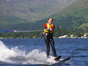 A girl waterskis in the Lake District, England.
