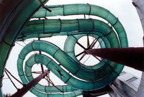 This water slide is built around several steel columns, which hold up the fiberglass segments with strong cantilever supports.