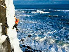 Extreme Sports Image Gallery An ice climber scales a waterfall above the ocean in Kaldakinn, Iceland. See more pictures of extreme sports.