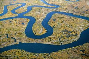 Every land mass eventually feeds into a body of water.
