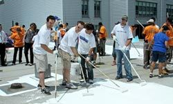 """Home Construction Pictures Players from the New York Mets help coat the rooftop of the Bedford-Stuyvesant YMCA with a cool reflective paint at the """"Cool The Roof"""" project, in Brooklyn, New York, in June 2010. See more pictures of home construction."""