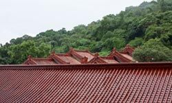 """Both traditional and """"cool colored"""" tiles can be good choices for cooling a steep-sloped roof."""